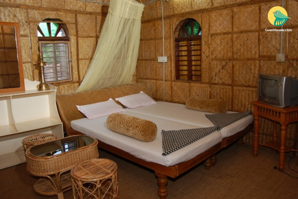 Stay in a bamboo cottage in our homestay