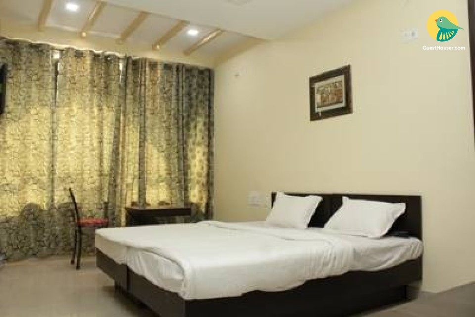 Well-appointed room in a guest house, ideal for a restful stay