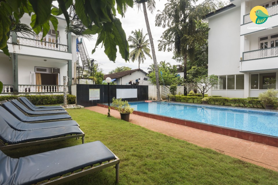 Boutique room in Candolim with a swimming pool