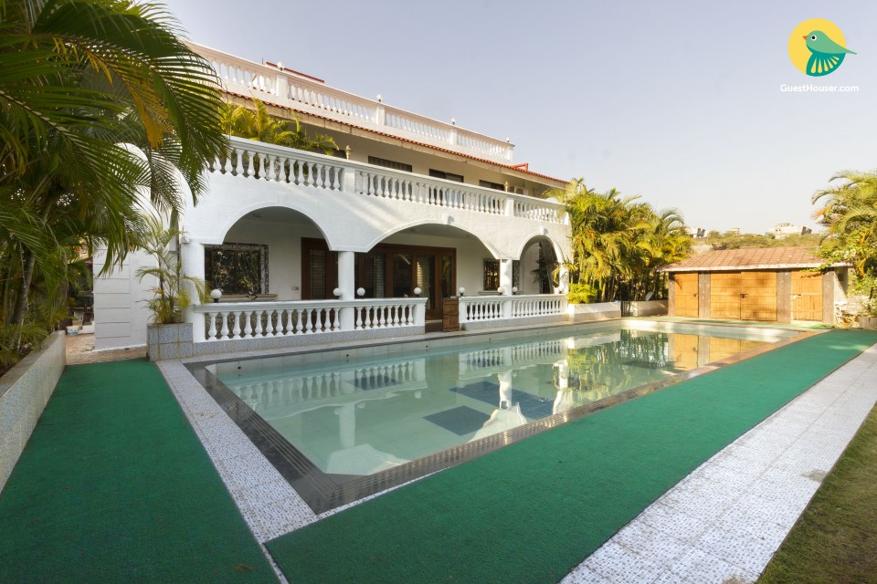 Regal 4-BR bungalow with a pool, tucked in serenity