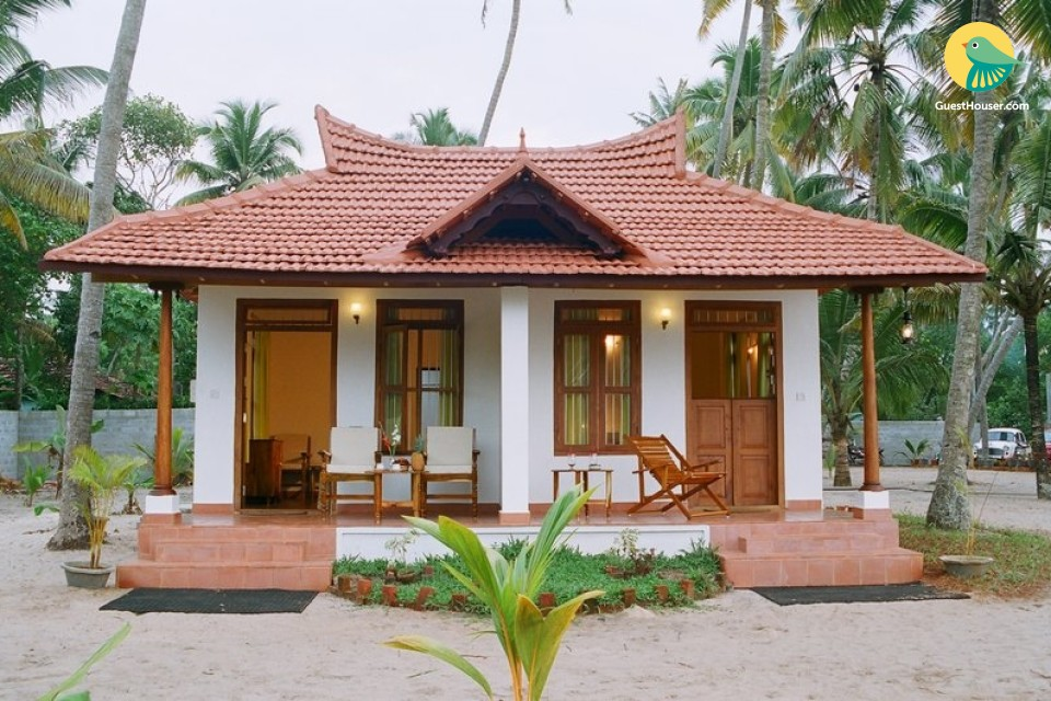 Beachside cottage amidst palm trees, ideal for a couple