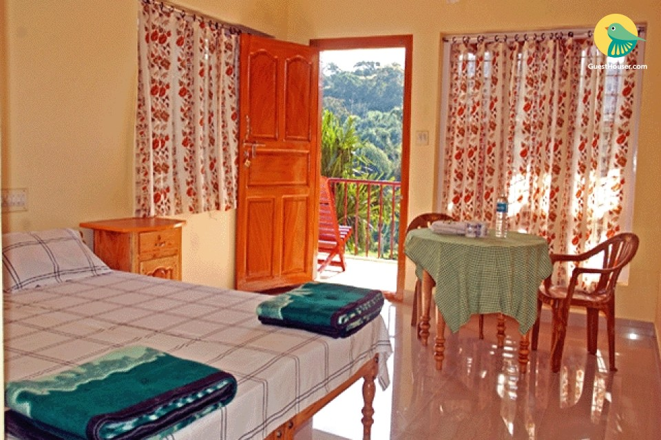 Homely room with a view of the Periyar Tiger Reserve Mountains