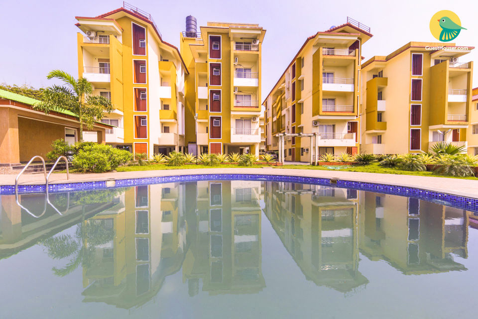 Contemporary 2 BHK for eight, with a pool