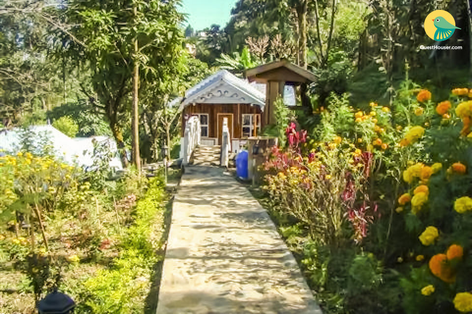 2-BR cottage amidst lush foliage, ideal for a small group